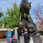 Peter Steven and Corey with the large Cougar statue - it was very bright